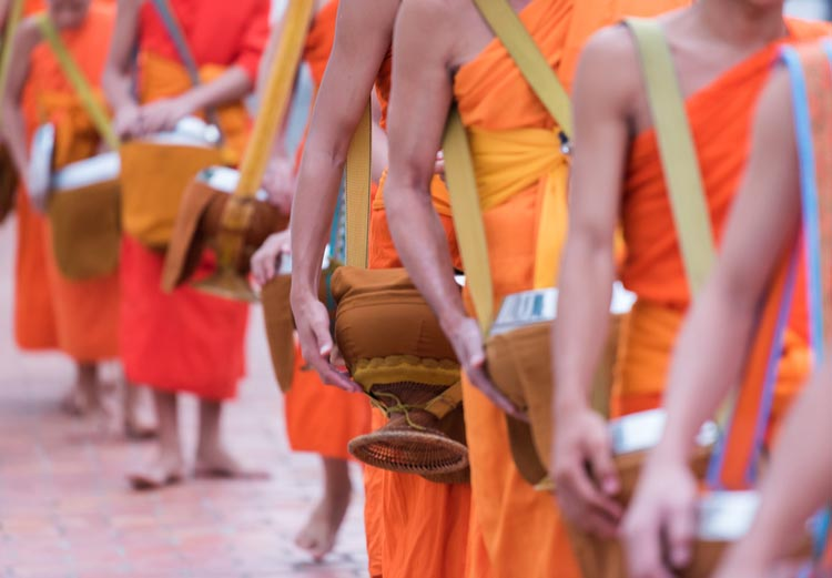 Monks carrying bowls